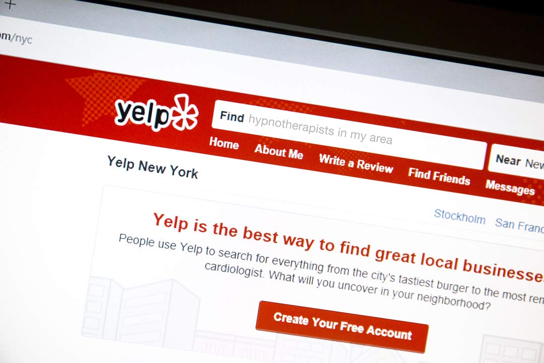 """image of yelp page on a computer with """"hypnotherapists in my area"""" as the search term"""